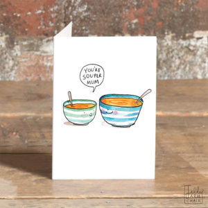A small green striped bowl of tomato soup and a larger blue striped bowl. Both are smiling. The small bowl is saying 'You're souper mum'.