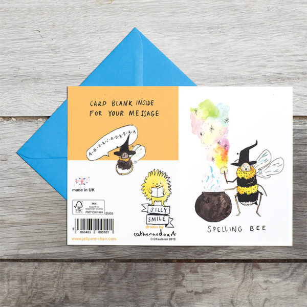 A bee holding a wand over a cauldron. The bee is also wearing a witches hat. Text reads 'Spelling Bee'. On the back of the card is a witch bee spelling.