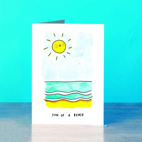 A blue background and a grey wooden table. A smiling sun on a pale blue sky above some calm waves. Text below reads 'Sun Of A Beach'.