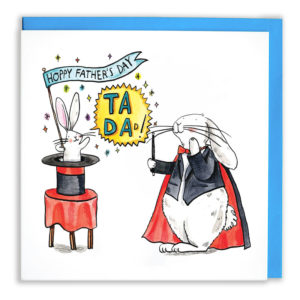 A white rabbit wearing a black blazer, cape, and a red bowtie. On a table is a top hat, inside is a baby rabbit saying 'Ta Da!' and holding a little flag which reads 'Hoppy Father's Day', the bunny is surrounded with sparkles.