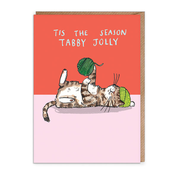 Top half of card red, bottom half pink. A tabby cat wearing a green bobble hat and playing with a dark green ball of wool/ Text reads 'Tis the season tabby jolly'.