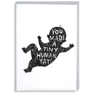 A black scribbled silhouette of a baby, inside in white it says 'You made a tiny human yay!'.