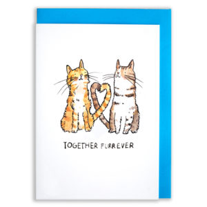 A card with a blue envelope tucked inside. Two cats, one ginger and one tabby. They are looking at each other and entwining their tails to create a heart. Text below reads 'Together Furrever'.