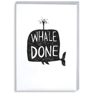 A black silhouette of a whale, inside in white it says 'Whale Done'.