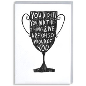A black silhouette of a trophy, inside in white it says 'You did it! You did the thing & we are oh so proud of you'.