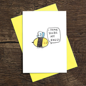 A little fuzzy bee is smiling and saying 'I think you're my knees'.