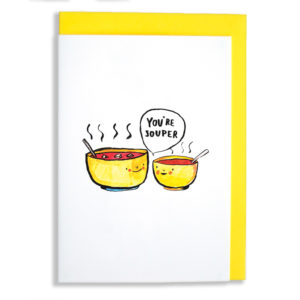 A yellow envelope with card. Two yellow bowls of tomato soup. The bowls are both smiling at each other, the smaller bowl is saying 'You're souper'.
