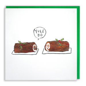 A card with a green envelope tucked inside. Two chocolate boule logs are smiling at one another. The speech bubble above them reads 'yule do'