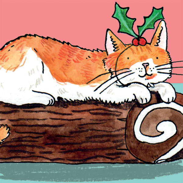 A ginger and white cat laying on top of a Christmas Yule log. The cat has a holly leaf on its head.