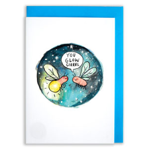 A card with a blue envelope tucked inside. A circle of watercolour blue in different shades. Inside the circle are two glow worms, one is glowing and one is not. The worm not glowing is saying 'you glow girl'.