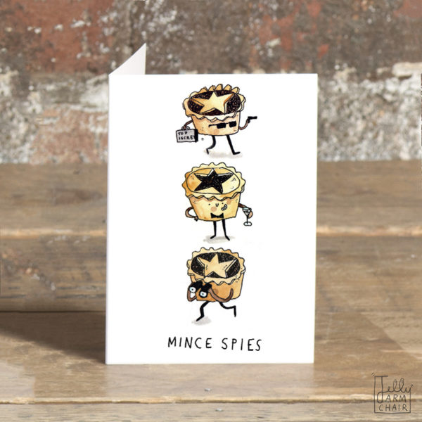 """Three mince pies, one has sunglasses, a gun and a brief case. One has a bow tie and cocktail, and one has binoculars. Text below reads """"Mince Pies'."""