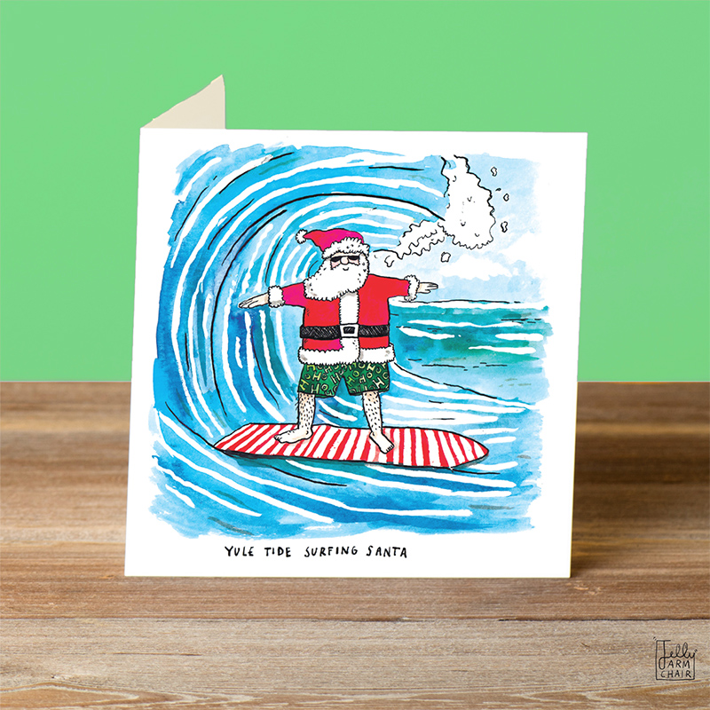 Yule-Tide-Surfing_Surfing-Santa-Christmas-card.-Beach-themed-Christmas-card_CH19_OT-1