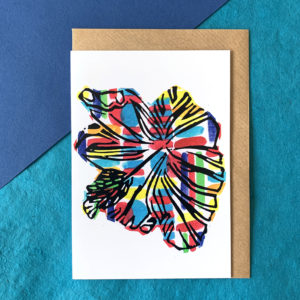 A white card with a multicoloured hibiscus