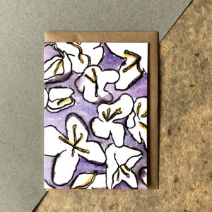 White lilies on a purple background