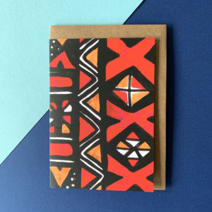 A card printed with a red African mud cloth patter