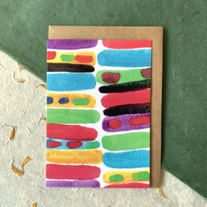 A white card with thick multicoloured horizontal stripes