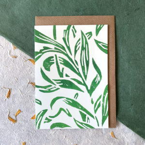 A white card with green vine leaves printed on it