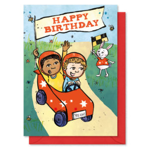 Two boys in a racing car holding a flag. Text in flag reads 'Happy Birthday'